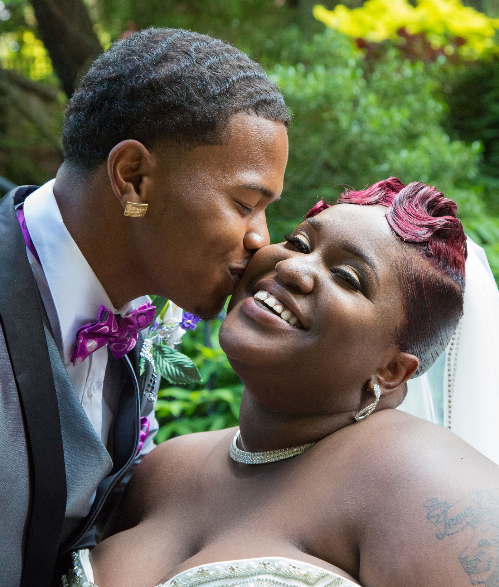 Rochester, NY Wedding groom kisses bride on cheek