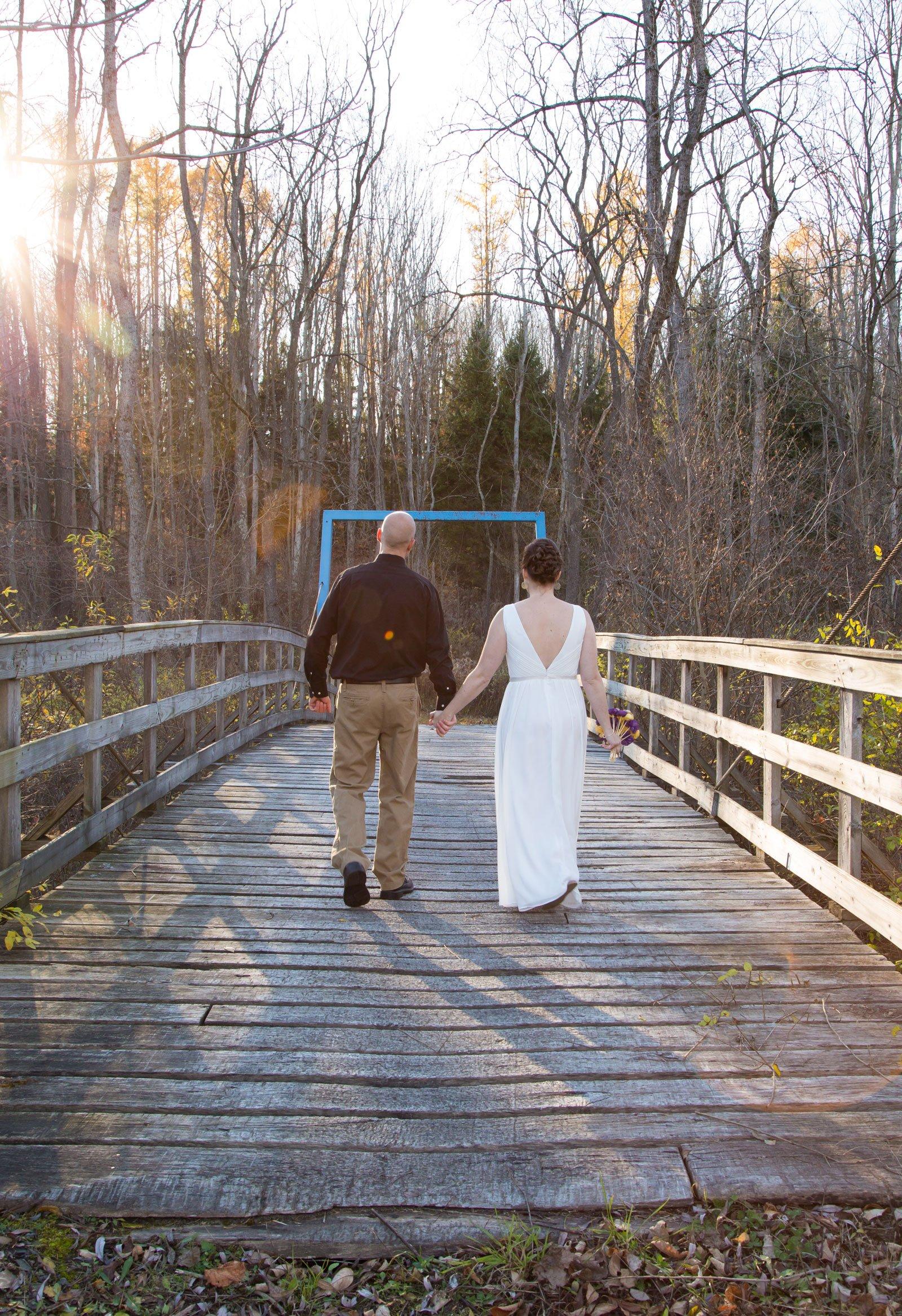 Erie, PA Wedding bride groom walk a bridge