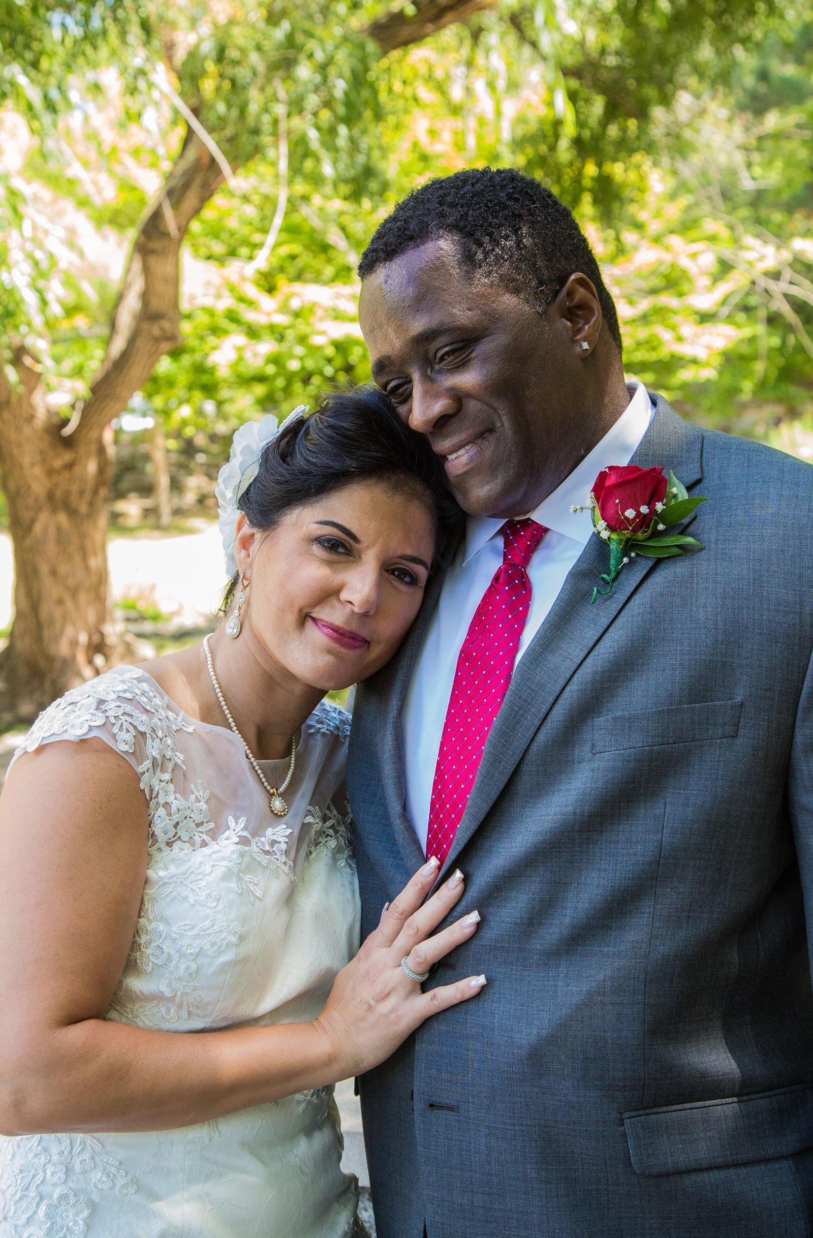 Williamsville, NY Wedding bride on her husband's shoulder