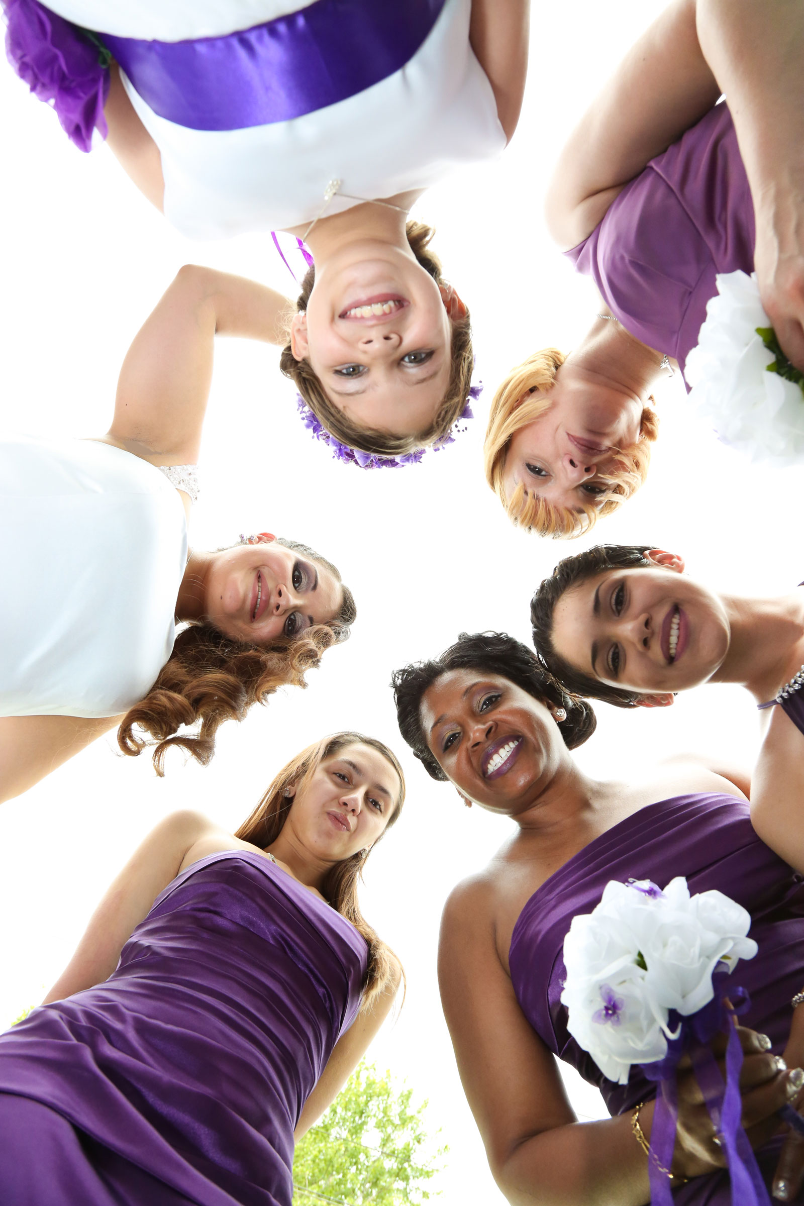 Buffalo, NY Wedding bridesmaid huddle with the bride