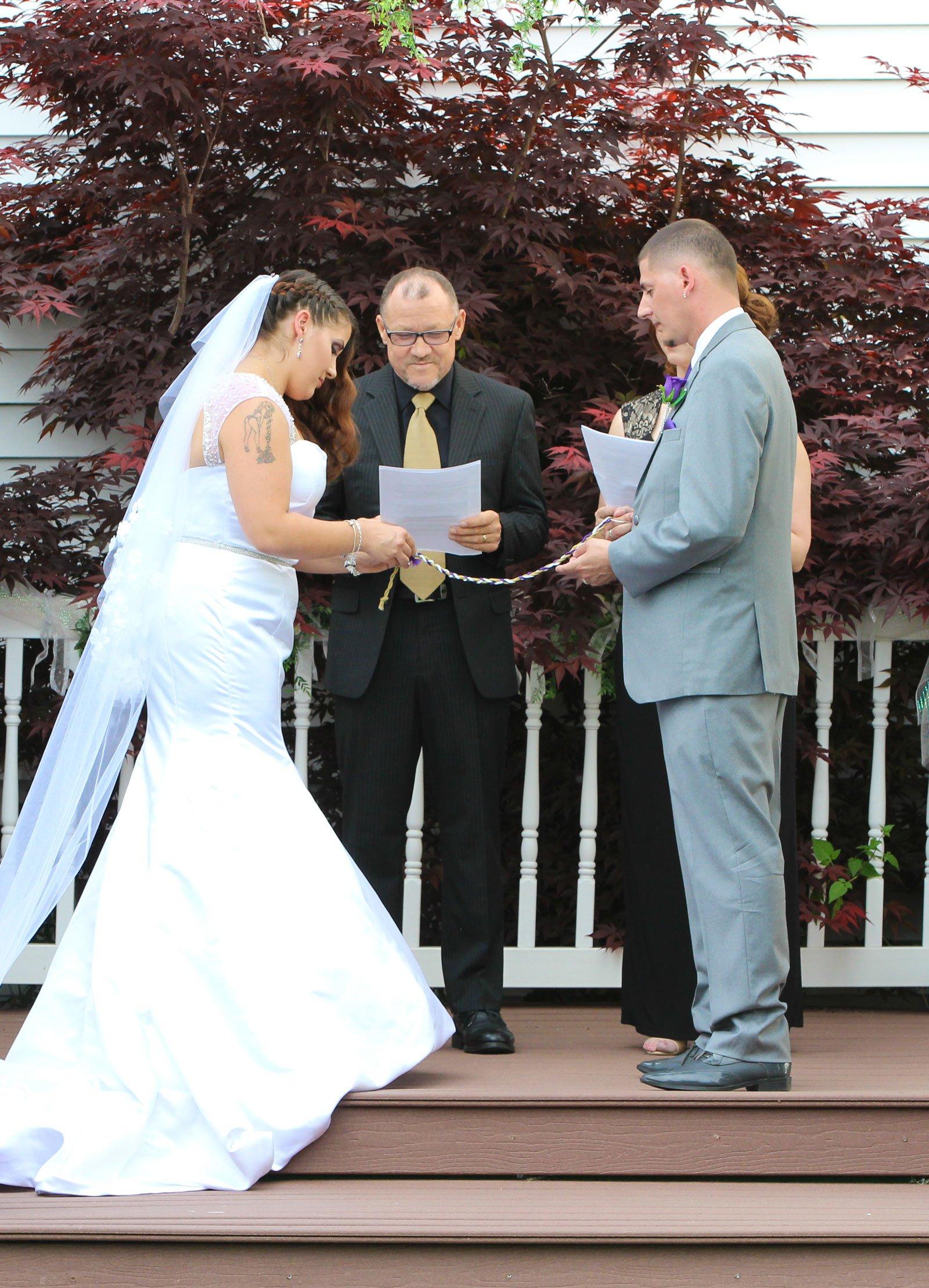 Buffalo, NY Wedding Ceremony bride reads vows