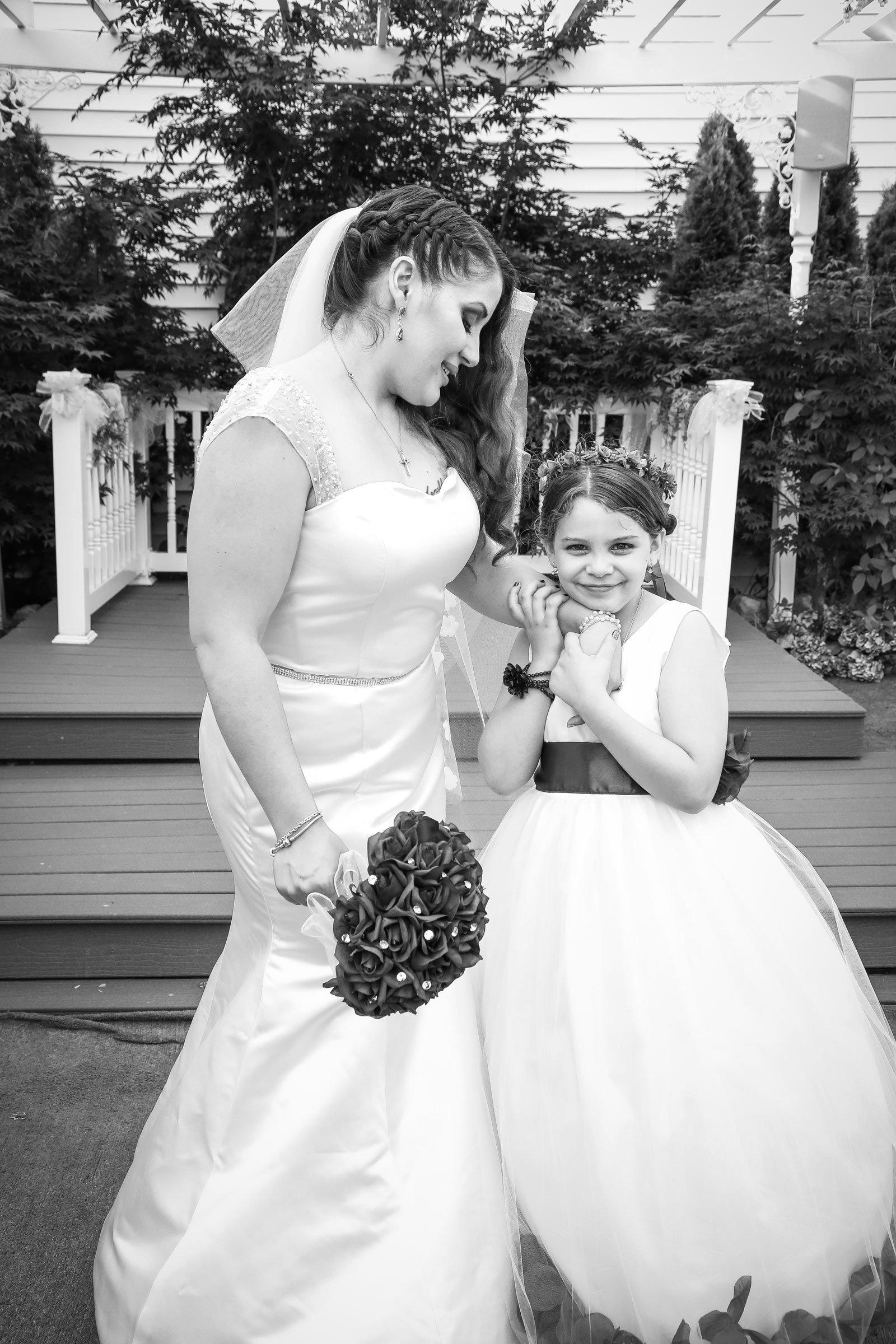 Buffalo, NY Wedding Ceremony flower girl with bride