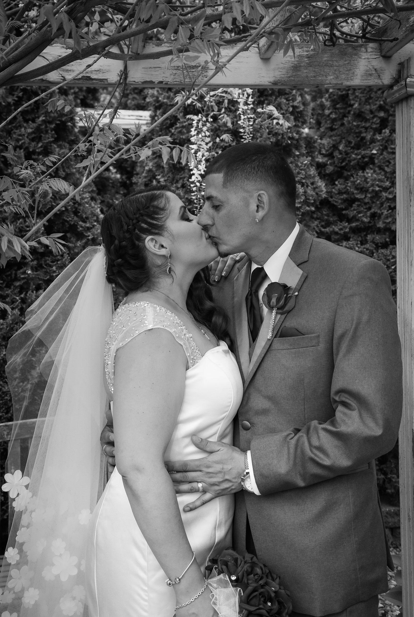 Buffalo, NY Wedding Ceremony bride and groom kiss