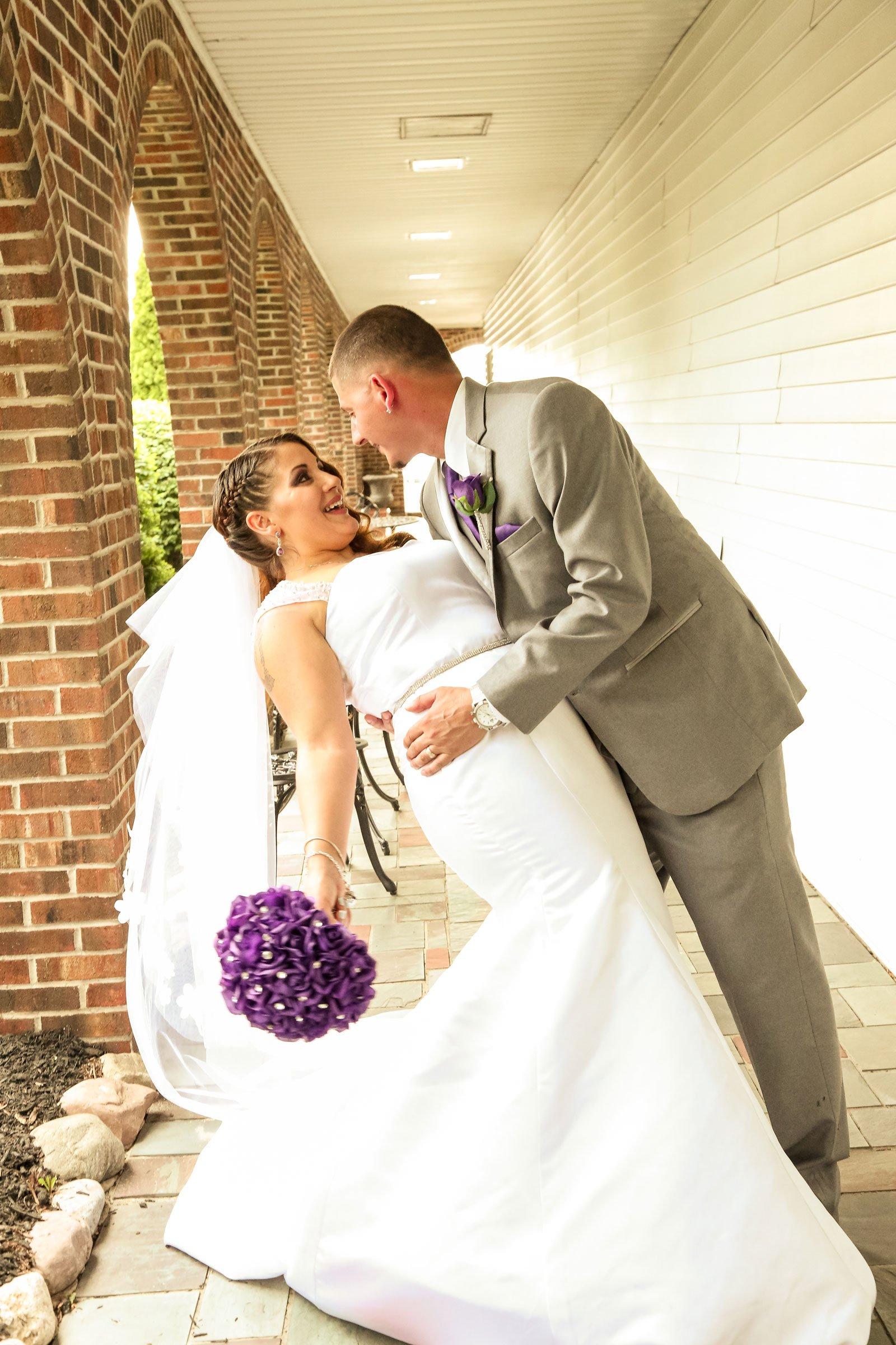 Buffalo, NY Wedding Ceremony groom dips bride
