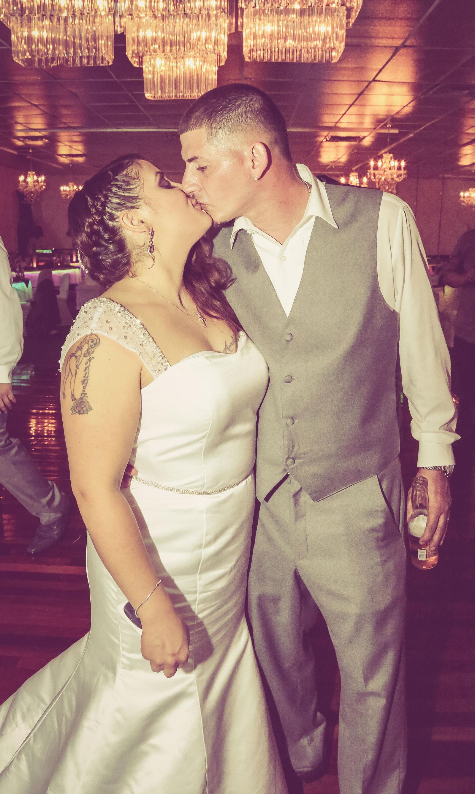 Buffalo, NY Wedding Reception groom kisses bride
