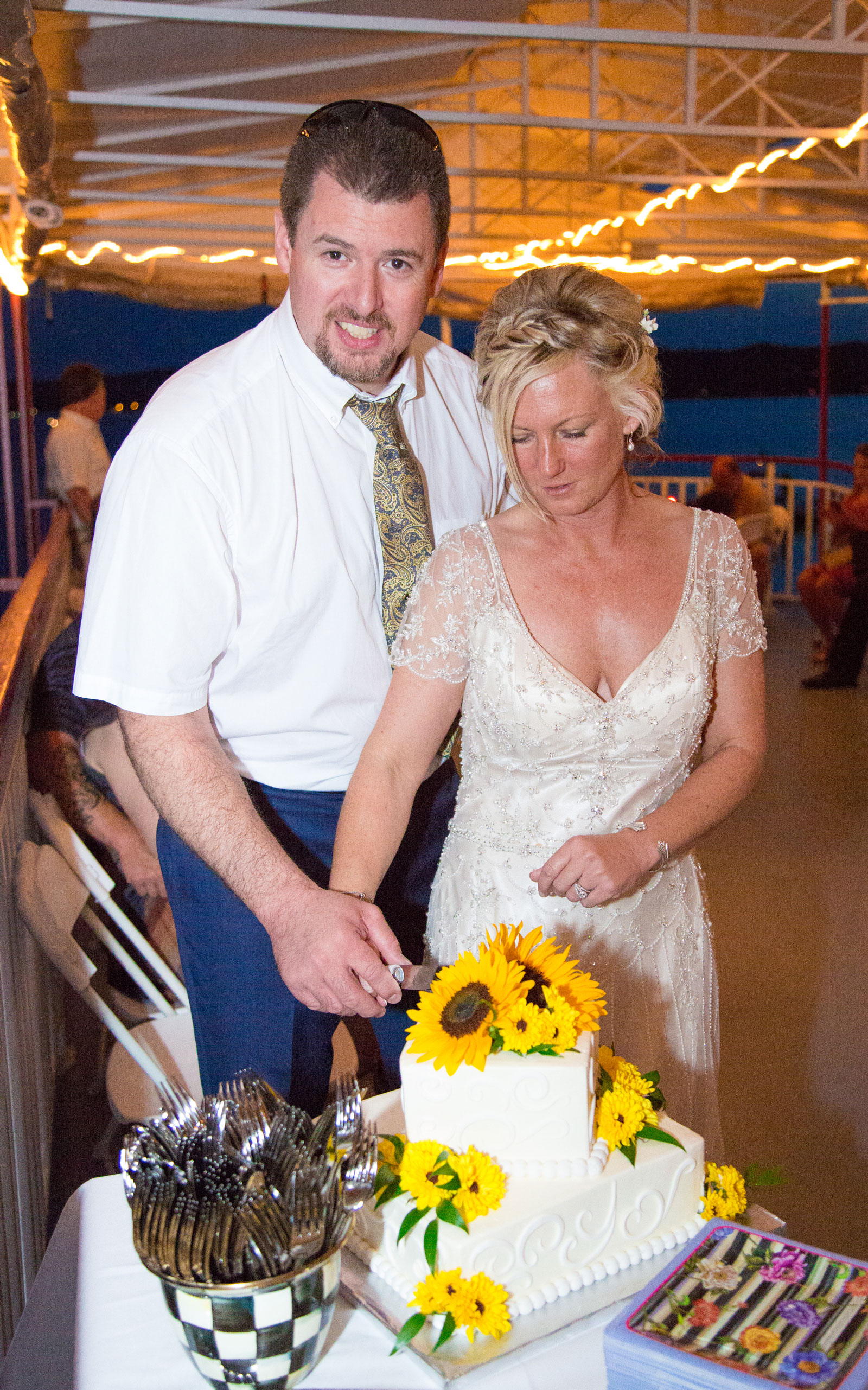 Canandaigua, NY Wedding Ceremony bride groom cut wedding cake