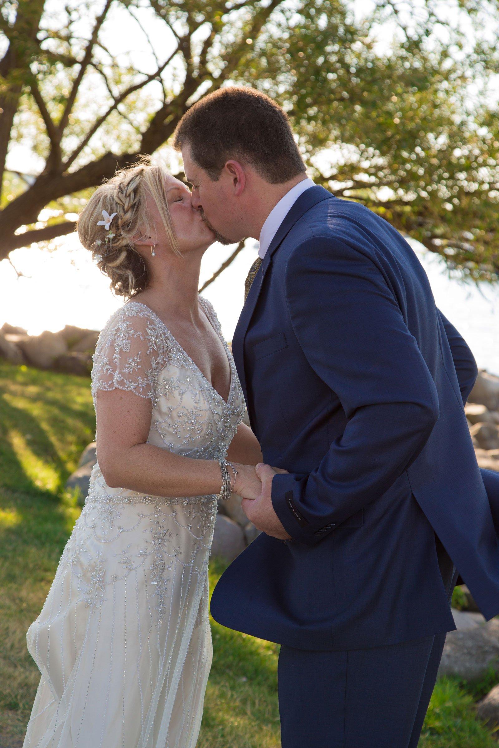 Canandaigua, NY Wedding Ceremony bride groom kiss