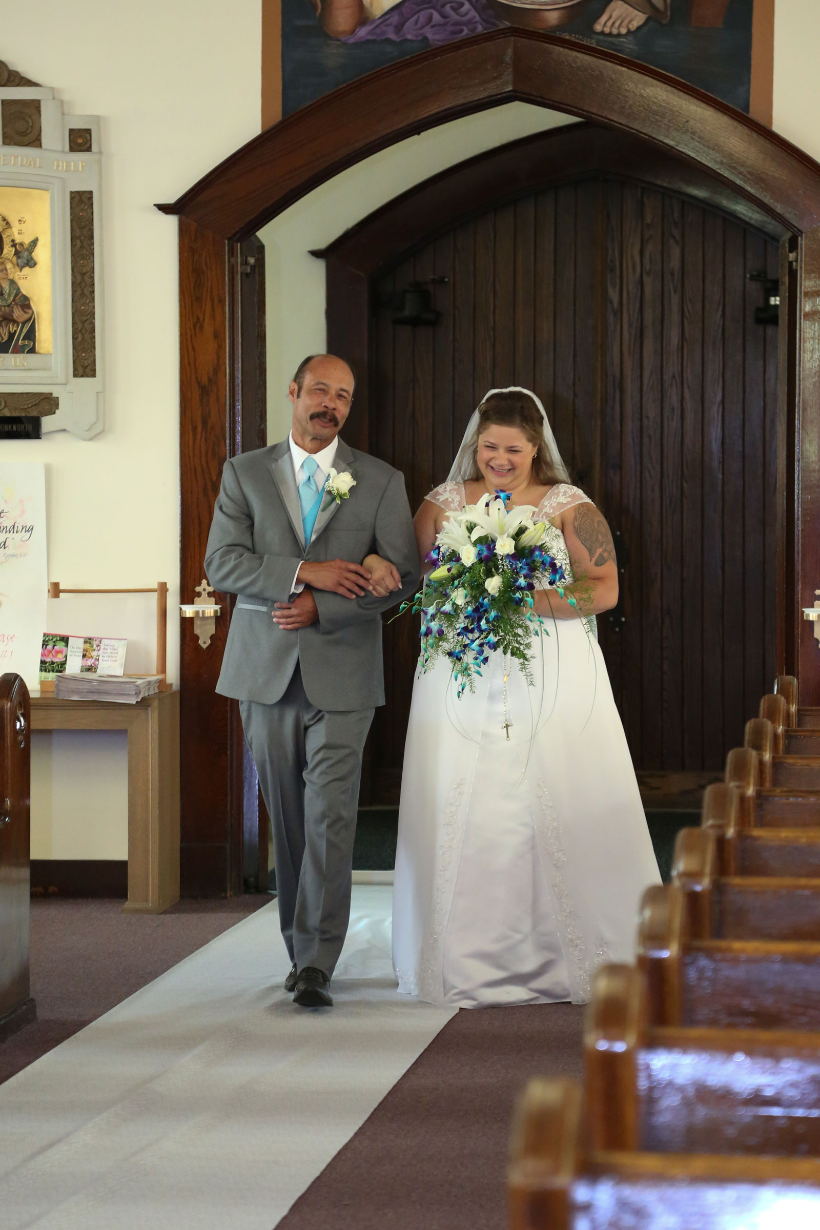Buffalo, NY Wedding bride comes down the aisle with dad