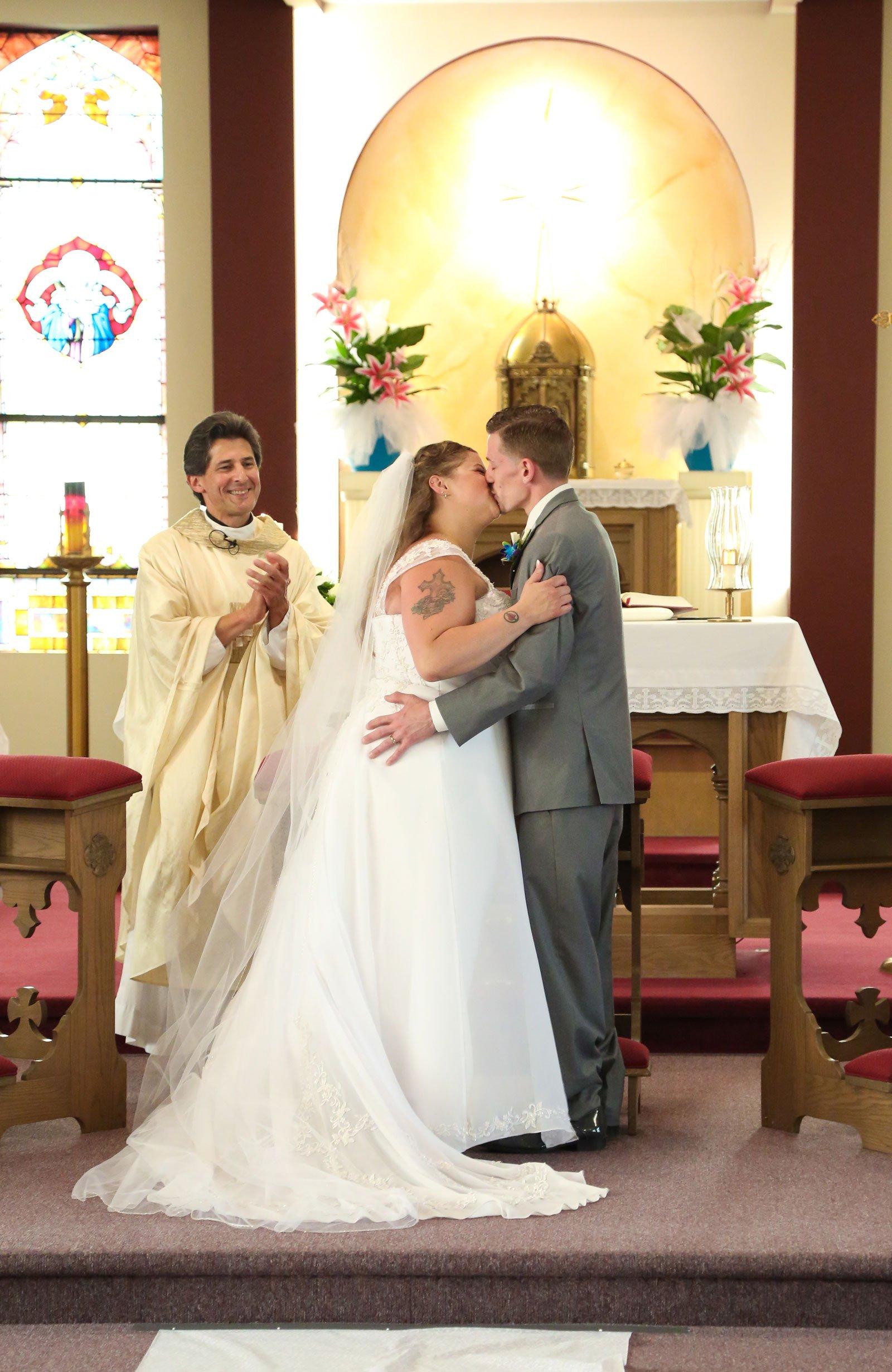 Buffalo, NY Wedding bride groom alter kiss