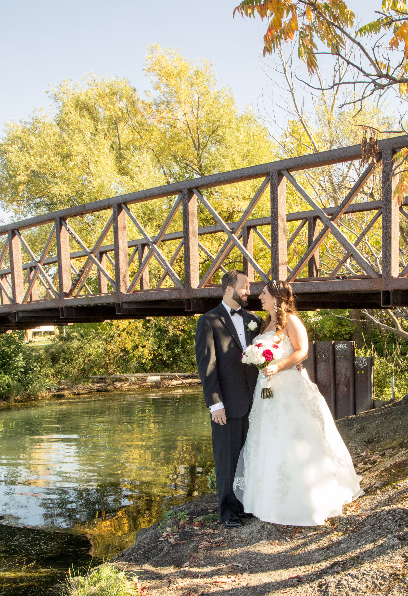 Lackawanna, NY Wedding bride and groom by a bridge