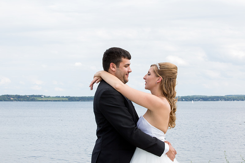 groom and bride by a lake