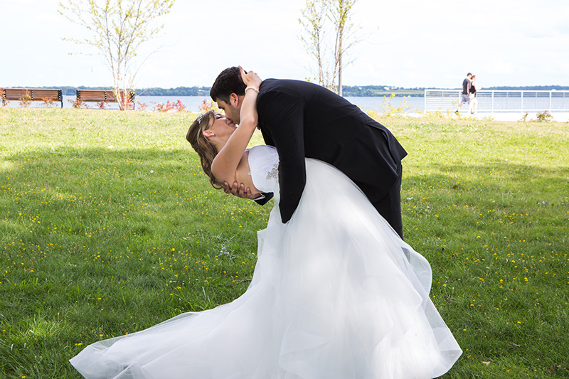 groom dips his bride and kisses