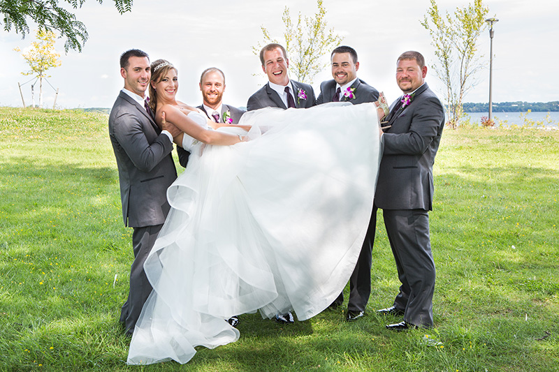 groomsmen holding the bride above the ground