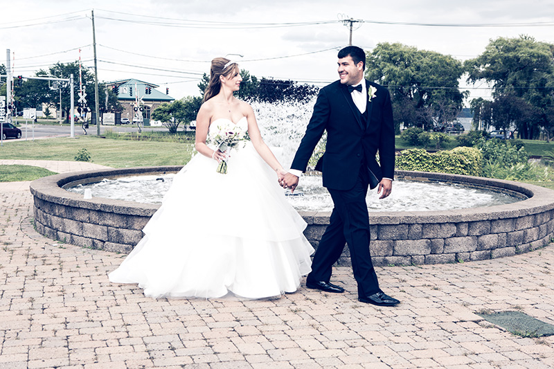 groom walking with his bride in the town square