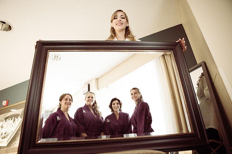 bridesmaids in a mirror