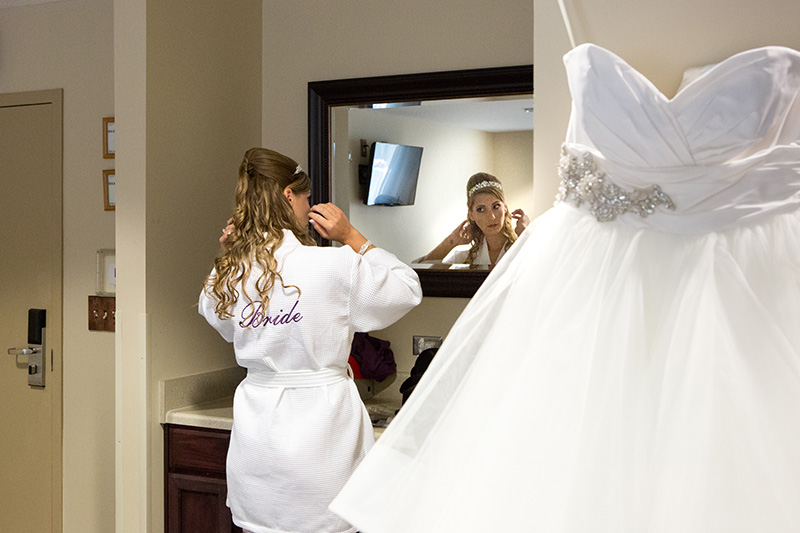 bride getting ready in her robe