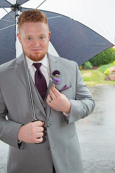 groom under an umbrella