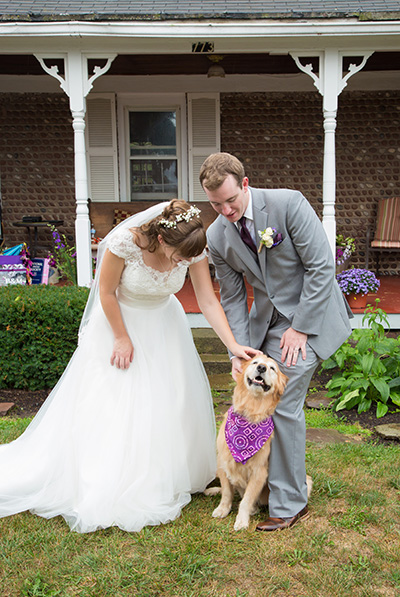 bride and groom with their doggy