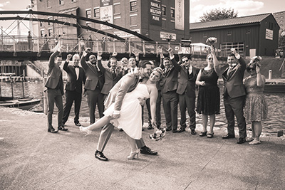 groom dances with his bride in the streets