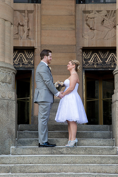 bride and groom on steps at buffalo city hall