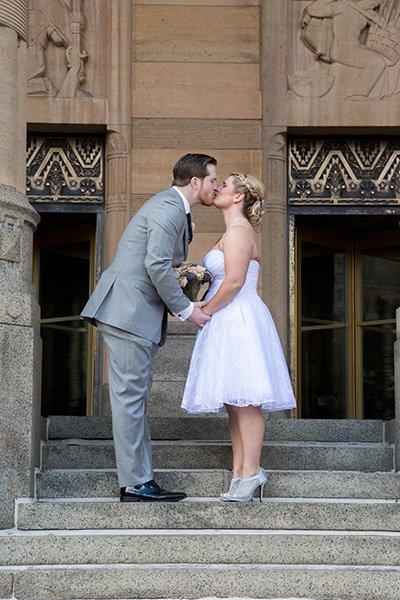 bride groom kiss at city hall in buffalo, ny