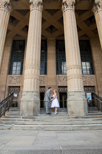 bride groom on steps of city hall in downtown buffalo