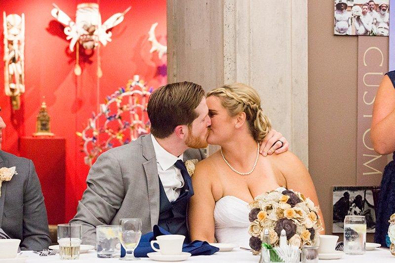 bride and groom wedding reception kiss