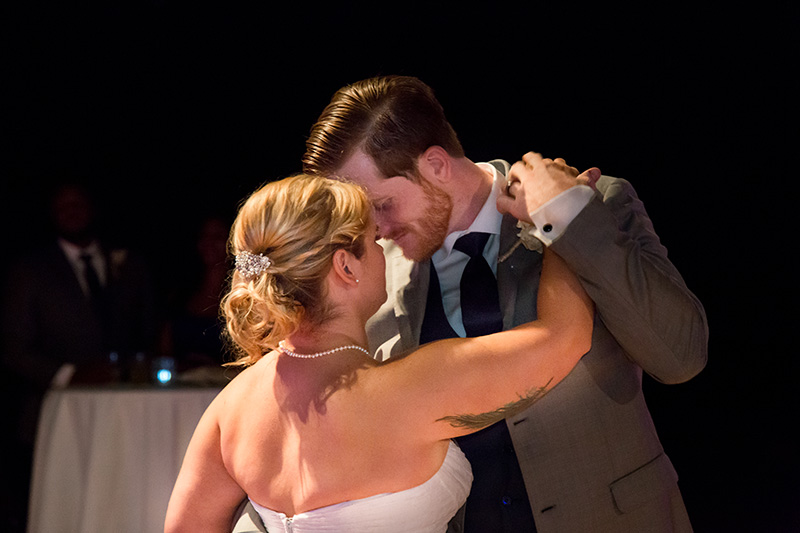 bride and groom dance close