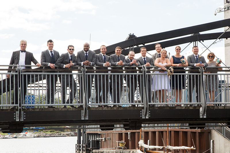 bridal party on bridge at channel side in buffalo