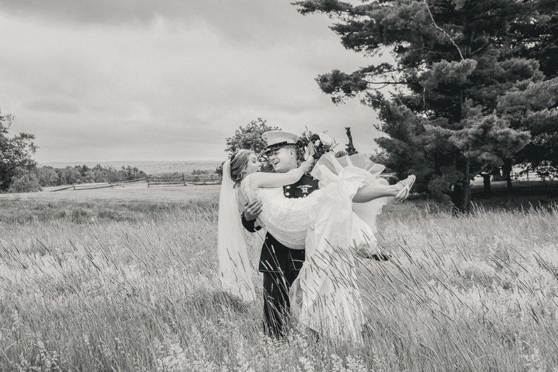 groom picks up his bride