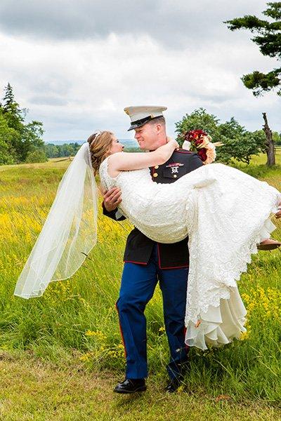 marine carries his beautiful bride