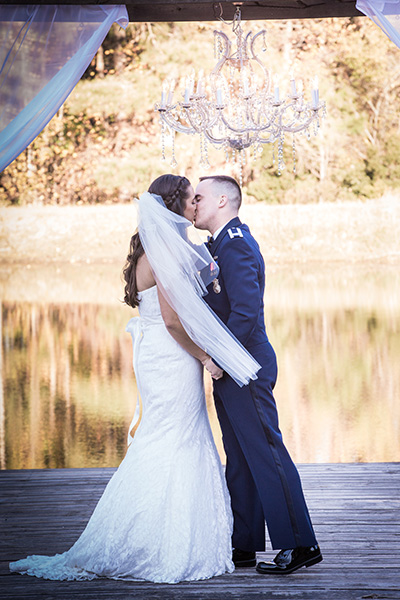 bride groom kiss by the water