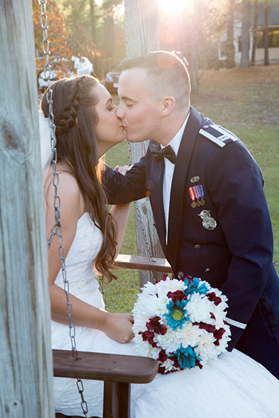 bride groom barn kiss