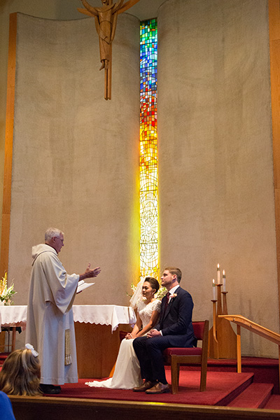 bride and groom at amazing alter