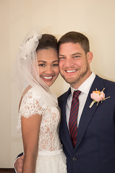 bride and groom cheek to cheek smile