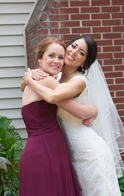 bride fun pose with a bridesmaid