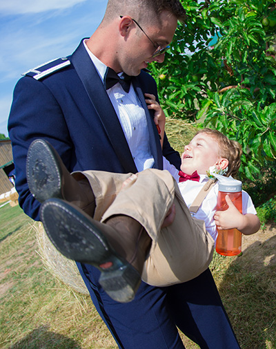 groom carries the ring bearer