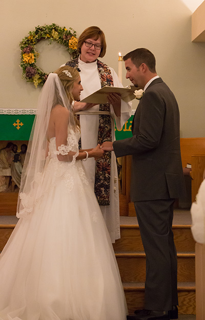 exchanging rings at the alter