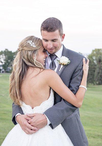 groom embraces his bride