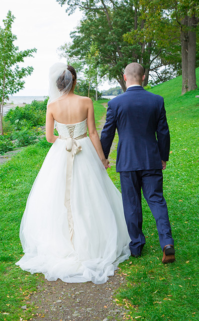 bride and groom walk hand-in-hand