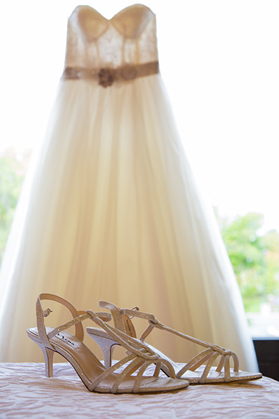 wedding dress and wedding shoes on display