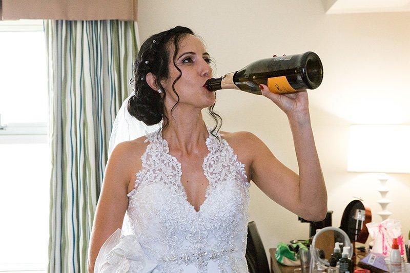bride having a little champagne