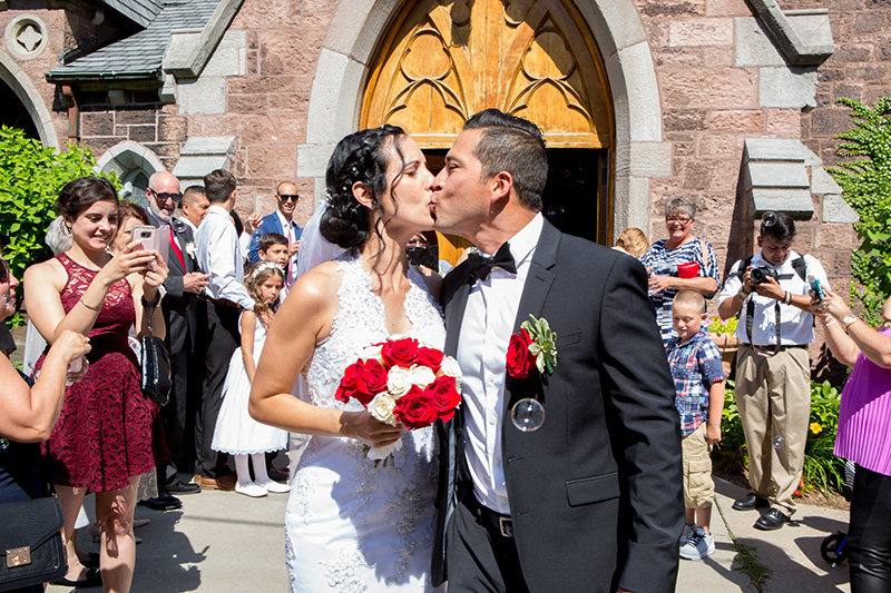 bride and groom outside a church