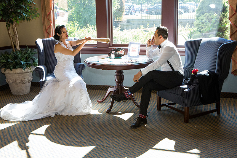 bride and groom having fun at a table