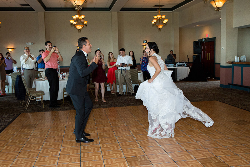 bride and groom dancing salsa