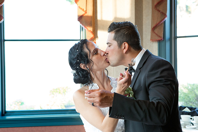 groom kissing his bride during their first dance