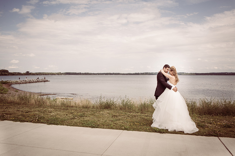 bride groom and by a lake