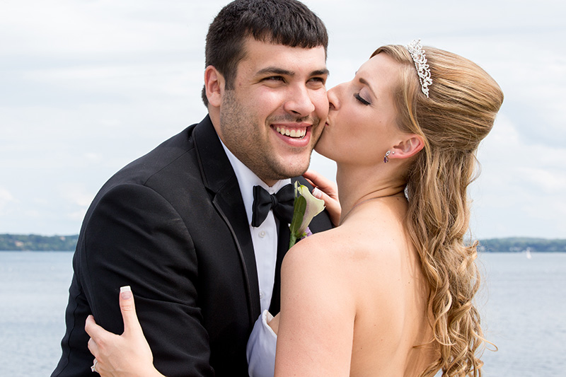 bride kisses her groom on the cheek
