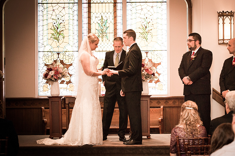 bride and groom at the alter