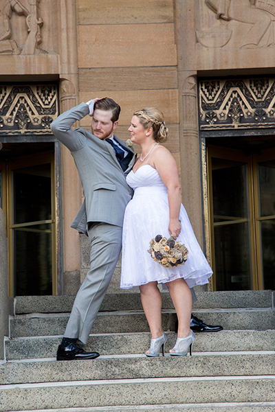 cool groom downtown buffalo city hall pose